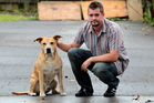Toby Conway pictured with Stan two years ago, claims his dog died on holiday. Photo / Doug Sherring
