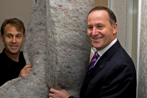 John Key marks the first two months of the Government's home insulation scheme in 2009.  Photo / David Rowland