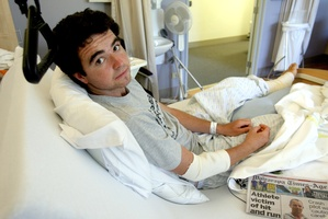 Daniel Anstis in his hospital bed after surgery on his leg. Photo / Wairarapa Times-Age