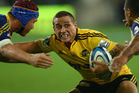 TJ Perenara of the Hurricanes is tackled during the round five Super Rugby match between the Highlanders and the Hurricanes. Photo / Getty Images.