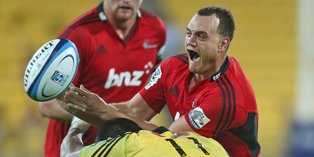 Israel Dagg passes the ball while being tackled by Julian Savea. Photo / Getty Images
