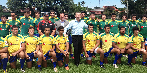 John Key pays a visit to the Brazilian under-19 rugby team. Photo / Claire Trevett