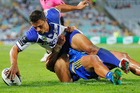 Bulldogs wing Sam Perrett scores a try. Photo / Getty Images