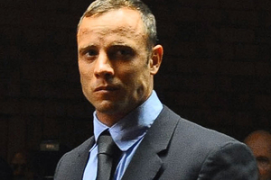 Oscar Pistorius is a broken man after the death of his girlfriend, his close friend Mike Azzie says. Photo / AP