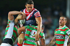 Sonny Bill Williams is tackled in last week's NRL opener against the Rabbitohs. Photo /Getty Images