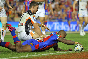Akuila Uate scores a try in Newcastle's opening round win over the Wests Tigers. Photo / Getty Images