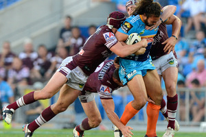 Ryan James of the Titans attempts to push through the Sea Eagles defence.  Photo / Getty Images