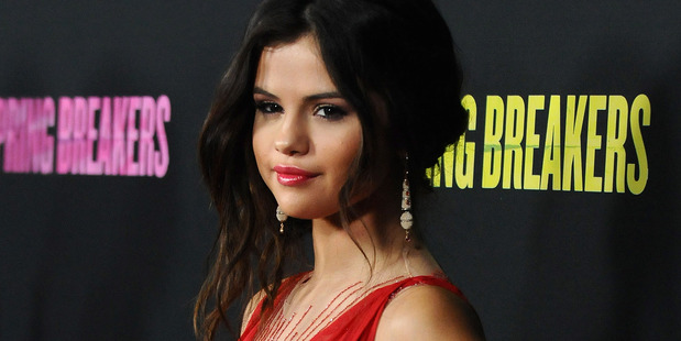 Selena Gomez is happy to have split from Bieber. Photo / AP