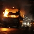 A gutted bus stands in the middle of the road after it was set on fire allegedly by the activists of Bangladesh National Party in Dhaka, Bangladesh. Photo / AP