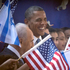 US President Barack Obama and Israeli President Shimon Peres, left, are greeted by children waving Israeli and American flags upon their arrival at the Peres' residence in Jerusalem. Photo / AP