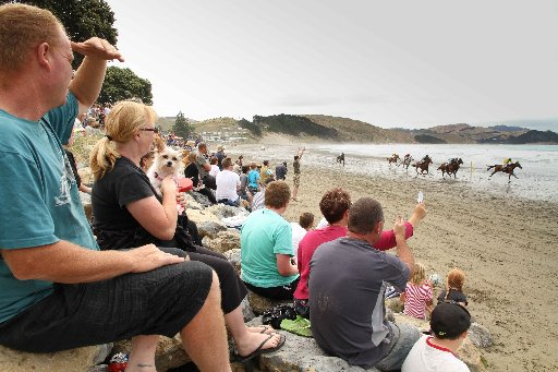Some of the more than 3500 people watch for the winners at Castlepoint Beach for the Castlepoint Racing Club Annual Picnic Meeting on Saturday.