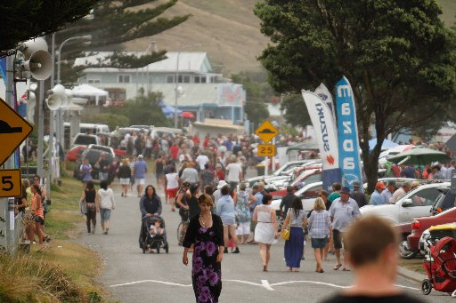 Race-goers and families crowd the beachfront and roadway during the annual race meeting at Castlepoint Beach on Saturday.