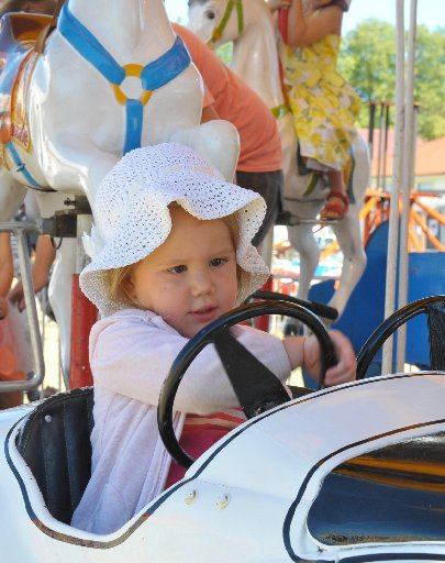 Hanatia Carswell, 2, from Masterton is all concentration in her roundabout car.