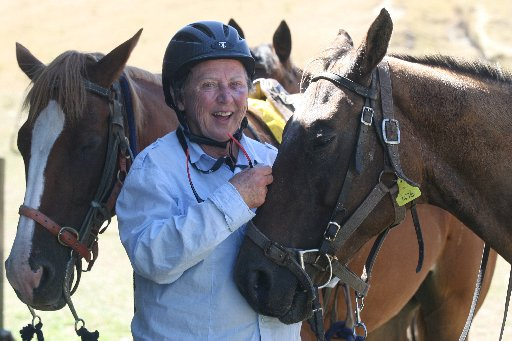 Stage 8 of the Great New Zealand Trek from Alfredton to Lake Ferry this week. The trek stopped at Whitespurs, Gladstone, on Tuesday.  Hilary Russell of Auckland kisses her hired horse.