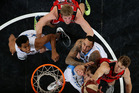Mika Vukona, Leon Henry and Tom Abercrombie of the Breakers contest arebound against Jesse Wagstaff and Cameron Tovey of the Wildcats. Photo / Getty Images.
