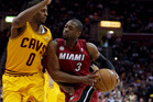 Miami Heat's Dwyane Wade (3) drives past Cleveland Cavaliers' C.J. Miles (0) during the first quarter of an NBA basketball game. Photo / AP.