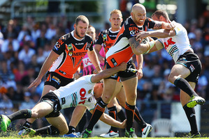 Keith Galloway of the Tigers is tackled by the Panthers defence during the round two NRL match between the Wests Tigers and the Penrith Panthers. Photo / Getty Images