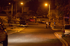 Police cordoned off the site of a stabbing in Ruahine St, Avondale, last night. Photo / Neville Marriner