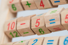 Children's maths skills can be improved by playing simple number games. Photo / Getty Images