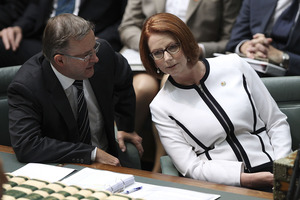 Prime Minister Julia Gillard and Labor MP Anthony Albanese speak during a day of high drama in Canberra yesterday. Photo / Getty Images
