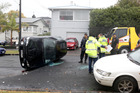 Police are investigating whether rain was a factor in this crash at Bungalow Ave in Pt Chevalier yesterday. Photo / Chris Gorman