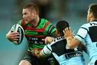 Chris McQueen of the Rabbitohs fights his way forward in last night's match. Photo / Getty Images