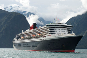 The 151,400-tonne Queen Mary 2 was overshadowed by the towering landscape as it cruised Milford Sound and neighbouring Dusky and Doubtful Sounds for the first time. Photo / James Morgan