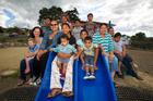 Taurus Cres adults Jenny Keown (left) Lisa Faatele, Nora Lepoalii and Maci Lemeki with local children. Photo / Richard Robinson
