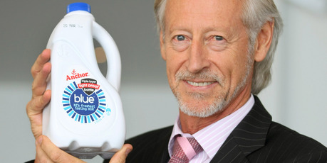 Fonterra's Peter McClure with the new light proof milk bottle. Photo / Chris Gorman