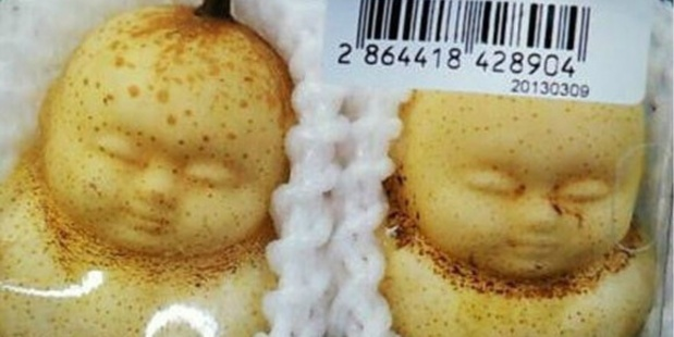"These unnerving anthropomorphic pears, shaped during initial stages of growth using special moulds, were seen at a supermarket in Beijing and are called ""happy/joyful doll pears"". Photo / Supplied"