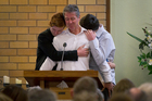 Ian Farrelly (C) and his two sons Ben Farrelly (L) and Nick Farrelly (R) speaking at the funeral of their wife and mother, Jane Farrelly. Photo / Sarah Ivey