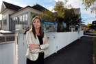 Sally Hughes of the Save Our St Heliers lobby group outside a Goldie St property. Photo / Doug Sherring