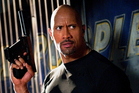 Former pro wrestling star Dwayne Johnson plays heavy weapons expert Roadblock in G.I. Joe: Retaliation.  Photo / Supplied