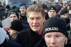 US actor David Hasselhoff, center, is surrounded by police officers as he attends a protest against the removal of a section of a historic part of the former Berlin Wall. Photo / AP