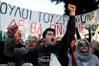 Protesters chant slogans outside the Cypriot Parliament against a vote on a plan to seize part of depositors' bank savings. Cypriots want to avoid treading in Greece's footsteps. Photo / AP