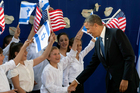 US President Barack Obama, right, shakes hands with Israeli children as he is welcomed by Israeli President Shimon Peres. Photo / AP