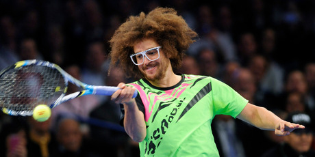Redfoo of LMFAO returns the ball to Serena Williams. Photo/AP