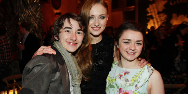 Loading On-screen sisters, Sophie Turner and Maisie Williams with castmate Isaac Hempstead Wright. Photo / AP
