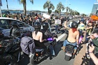 Protesters hold signs at the Boobs on Bikes parade. Photo / Bay of Plenty Times