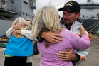 Tania Davies and Steve Jones greet family members at Devonport Naval Base. Photo / Steven McNicholl