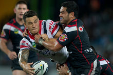 Sonny Bill Williams of the Sydney Roosters and Konrad Hurrell of the Warriors. Photo / Brett Phibbs