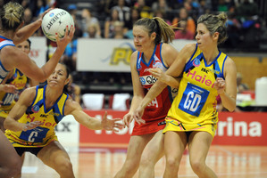 Victoria Smith (right) is in a constant battle to balance work and netball life. Photo / NZPA