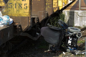 The wheelchair sits at the scene at the Morningside Drive rail crossing. Photo / Brett Phibbs