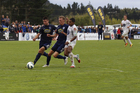Auckland City defender Simon Arms, middle, brings down Roy Krishna which led to a red card. Photo / James Harper