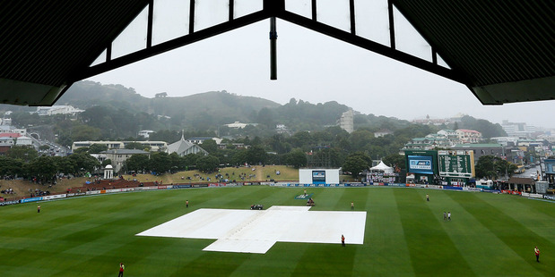 The covers sit on the pitch during a rain delay at the Basin Reserve. Photo /Getty Images