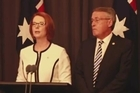 Australian Prime Minister Julia Gillard faces down a leadership challenge, emerging victorious from a party vote after former leader Kevin Rudd makes a last-minute decision not to run.