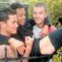 Connor Kelly, left, and Jade Payne hold Adrian Davids to take the weight off his leg after he slipped on a gate and a spike went through his right thigh. Photo / Supplied 
