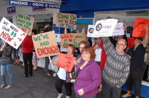 NOVO PROTEST: A group of teachers and school staff protested outside the electoral office of Wairarapa MP John Hayes. PHOTO/NATHAN CROMBIE
