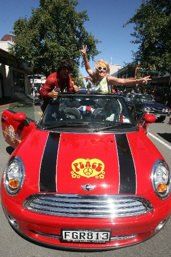 GROOVY BABY: Richard James (Austin Powers) and Alex Frankpitt (Felicity Shagwell) of Papamoa in their 2010 Mini Cooper.