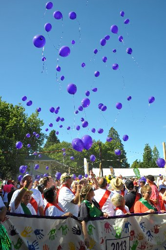 GOOD CAUSE: Survivors release their balloons after walking the first lap.